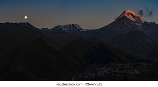 View of Kazbegi mountain and the moon from Rooms hotel, Stepantsminda, Georgia