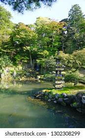 View of the Kenroku-en gardens near Kanazawa Castle (Kanazawa-jo),  a landmark  located in Kanazawa, Ishikawa, Japan