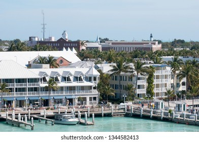 The view of Key West downtown marina with historic lighthouse in a background (Florida).