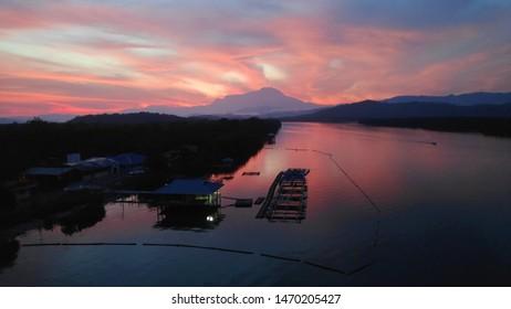 view of kinabalu mountain sunrise from gayang bridge, tuaran sabah, malaysia.