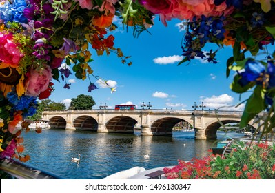View of Kingston bridge upon Thames surrounded by flowers in a sunny day of summer in London
