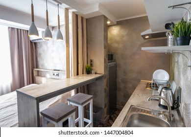 View of the kitchen and bar in a small hotel room - studio