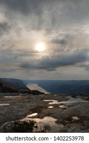 View from Kjerag mountain to Lysefjord and evening sun. Summer in Norway.