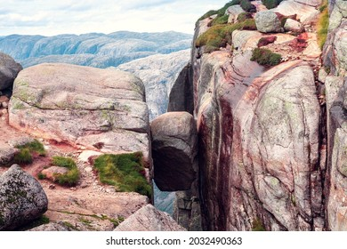 view of the Kjerag stone in the mountains of Norway