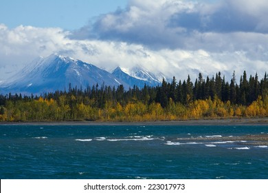 View of Kluane Lake and snow capped St. Elias mountains from shore near Kluane National Park, Yukon, Canada