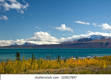 View of Kluane Lake and St. Elias mountains with lookout structure, near Kluane National Park, Yukon, Canada