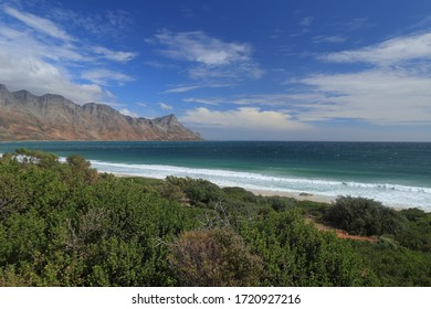 The view of Koeel Bay and Dappat Se Gat Beach as seen from Clarence Drive or R44 Road in Gordon Bay, South Africa.