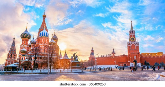 View of Kremlin and Cathedral of St. Basil at the Red Square at sunset winter in Moscow, Russia