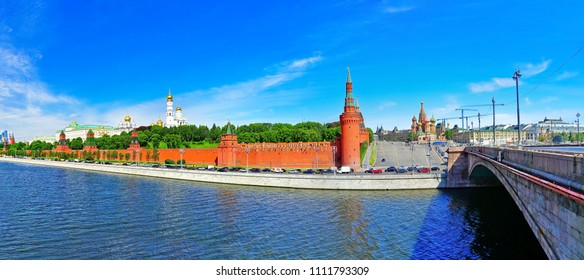 View of Kremlin and Red Square along the Moscow River in summer in Moscow, Russia.