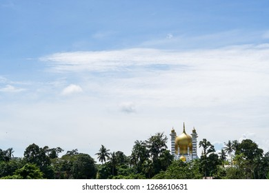 A view of Kuala Kangsar green nature,skies and mountain scenery with ubudiah mosque or masjid ubudiah view in the background. Kuala Kangsar city is a Perak Royal City located in Perak,Malaysia - image