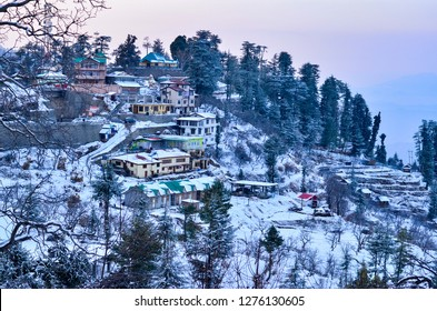 View of Kufri village 15 Kms above Shimla, Himachal Pradesh, India at sunset. It is a popular winter getaway where people come to enjoy snowfall, skiing and winter sports.