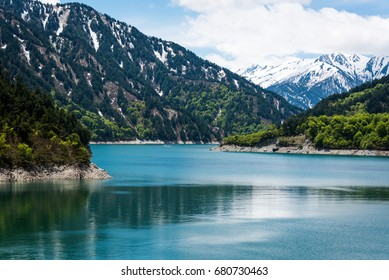 View of Kurobe dam, layer of mountain, green and snow