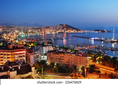 View of Kusadasi harbor by night. Turkish. Kusadasi name of  the city is a port of call for cruise ships plying the Eastern Mediterranean.