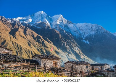 View of Kutang Himal range with Khayang & Saula Himal peaks on Nepal-Tibet border, towering above Shayala village below, Manaslu Circuit trek, Manaslu Himal, Gorkha district, Nepal Himalayas, Nepal