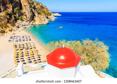 View of Kyra Pynagia beach and Greek chapel on hill top, Karpathos island, Greece
