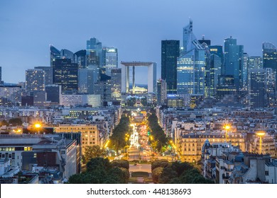 View of La Defence Paris business district from Place Charles De Gaulle at dusk.