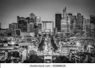 View of La Defence Paris business district from Place Charles De Gaulle at dusk. Black and white image.