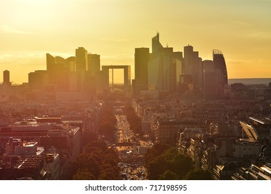 View of La Defence Paris business district from Place Charles De Gaulle at sunset.