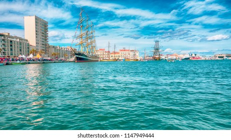 View of the lagoon with ships in the modern city of Sete France.