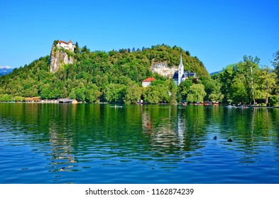 View of Lake Bled with dominant Bled Castle, Slovenia. According to written sources, it is the oldest Slovenian castle and is currently one of the most visited tourist attractions in Slovenia.