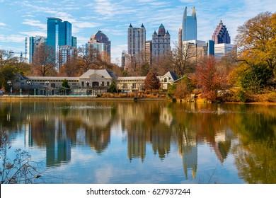 View of Lake Clara Meer, Piedmont Park Aquatic Center and Midtown Atlanta in sunny autumn day, USA