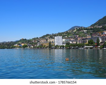 View to Lake Geneva and european Montreux city in canton Vaud in Switzerland, clear blue sky in 2017 warm sunny summer day on July.