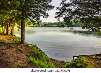 View of Lake Guery at sunset. Lake Guery is a mountain lake of volcanic origin located in Monts Dore, in heart of Massif Central. It is highest of the Auvergne lakes. Auvergne-Rhone-Alpes. France.