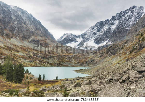 View of the lake Kuiguk. Peaks of the Altai Mountains. Russian autumn landscape