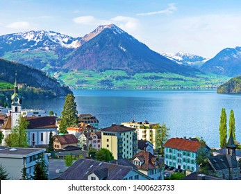 View of Lake Lucerne / Vierwaldstättersee (Vierwaldstaettersee or Vierwaldsattersee) with Vitznau settlement and Swiss Alps in the background - Canton of Lucerne, Switzerland