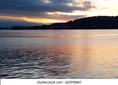 view of lake maggiore italy during sunrise - spring season