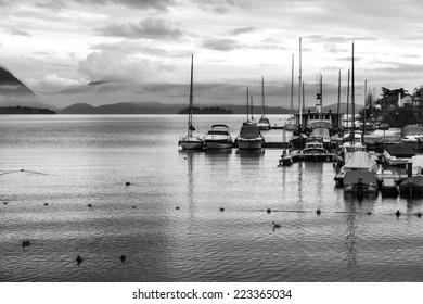 View of a lake marina with stormy clouds. BW image