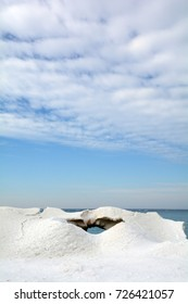 A view of Lake Michigan through an ice formation on a sunny, winter afternoon.