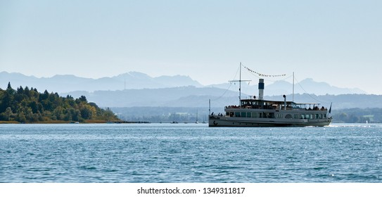 """View of the lake """"Ammersee"""" with a nostalgic paddle wheel steamer in Bavaria in the late summer"""