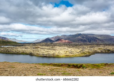 View of the lake on a background of mountains under clouds in Iceland