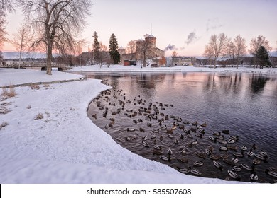 View of Lake Saimaa and medieval castle Olavinlinna in winter evening