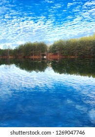 View of a Lake with Sky Mirrored in the Water