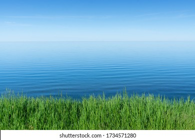 View to Lake Superior. Calm Background. Grass and Lake.