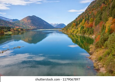view to lake sylvenstein and forest with colorful trees. indian summer in autumnal  landscape upper bavaria
