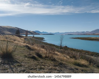 View of Lake Tekapo, New Zealand, with turquoise blue water and cloud