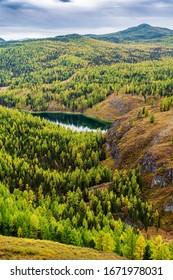 View of Lake Uchkol. Autumn taiga landscape. Ulagansky District, Altai Republic, Russia