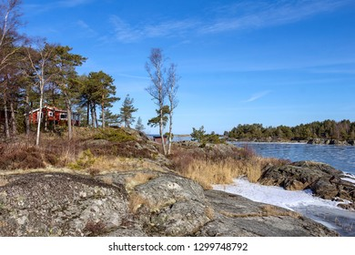 View to the lake Vanern with skerries in winter. Vanern is the largest lake in Sweden, the largest lake in the European Union. A skerry is a small rocky island. It may simply be a rocky reef.