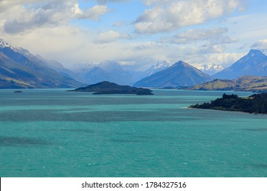 The view of Lake Wakatipu with clouds covering the snow-capped mountains in the distance. From the view of Bennetts Bluff Lookout.