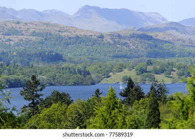 View of Lake Windermere and mountains from Bowness Lake District National Park Cumbria England