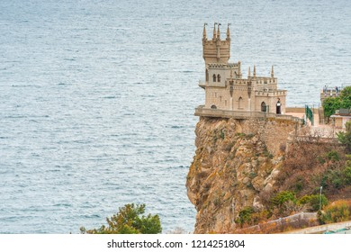 View of the landmark of Crimea - Swallow's Nest on the edge of a cliff against the background of the sea, Russia