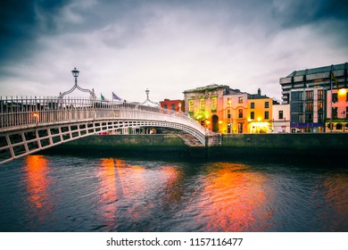 View of landmark Ha'Penny Bridge over the River Liffey seen at dusk