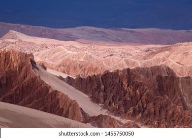 View of the landscape of the Atacama Desert. The rocks of the Mars Valley (Valle de Marte) and Cordillera de la Sal, Atacama Desert, Chile