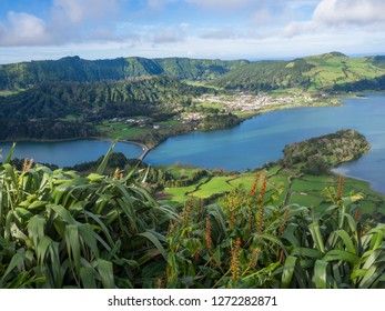 view of landscape with green and blue crater lakes of Lagoa Azul and Lagoa Verde and Sete Cidades village in the crater of dormant volcanoes, on Sao Miguel island, Azores, Portugal.