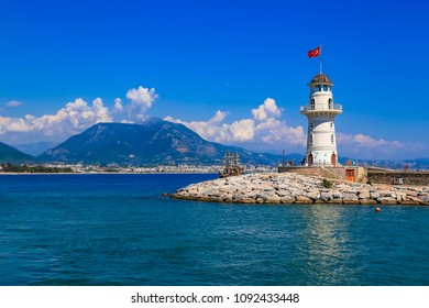 View of landscape and lghthouse of Alanya port with Turkish flag, Alanya, Turkey