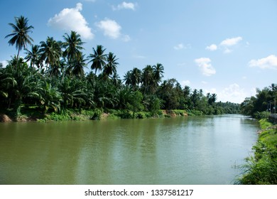 View landscape and motion flowing water of Sawi river at Sawi District in Chumphon, Thailand at front of Wat phra that sawi temple