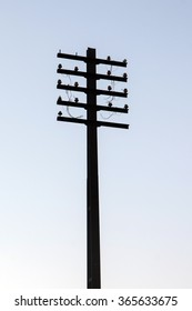 View of a large abandoned electrical pillar silhouette.
